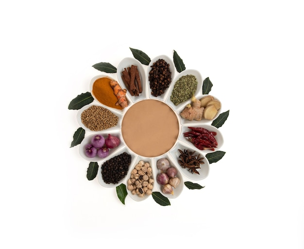 Herbs and spices of thailand in a ceramic spoon isolated  on a white surface. top view