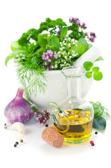 Herbs in a vase and olive oil