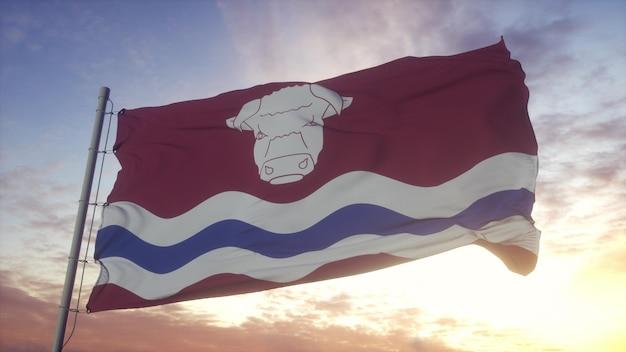 ヘレフォードシャーの旗、イギリス、風、空、太陽の背景で手を振っています。 3dレンダリング。