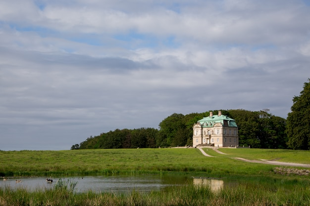 The hermitage, a royal hunting lodge in klampenborg of denmark. dyrehaven is a forest park north of copenhagen