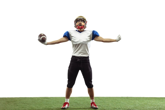 Hero, strong. american football player isolated on white studio background with copyspace. professional sportsman during game playing in action and motion. concept of sport, movement, achievements.