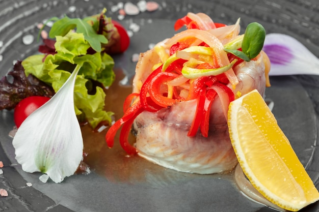 Herring fillet served with onion