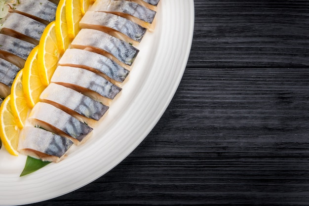 Herring fillets with onion and lemon slices