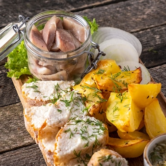 Herring with baked potato and bread.