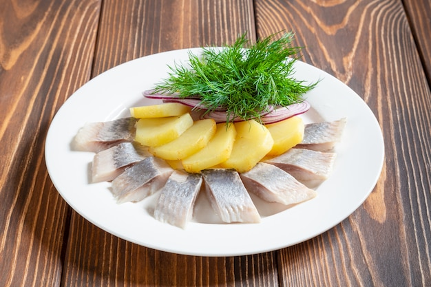 Herring with boiled potatoes and red onion