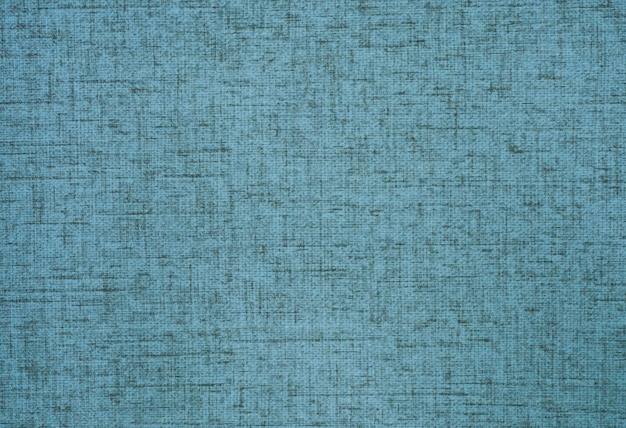 Hessian sackcloth canvas woven texture pattern background in light blue or teal color.