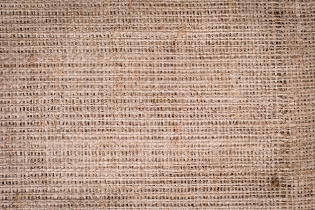 Hessian sackcloth woven texture pattern background in light cream beige brown color tone