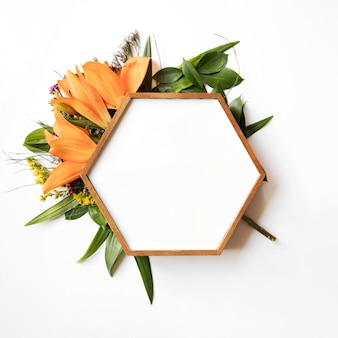 Hexagon frame on leaves and lilies