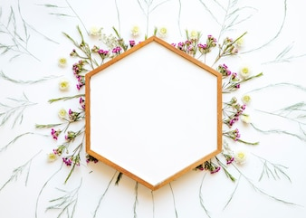 Hexagon frame on lovely wild flowers