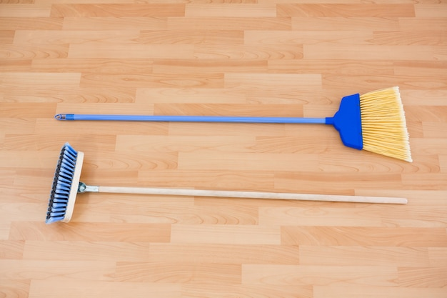 Hgh angle view of long handle brooms