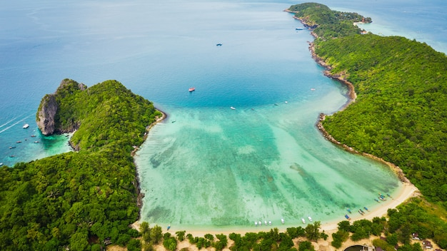 Hi season boat and tourists on phiphi island krabi thailand aerial view from drone