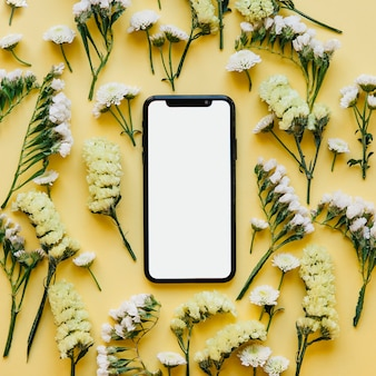 Hi-tech smartphone in soft flowers