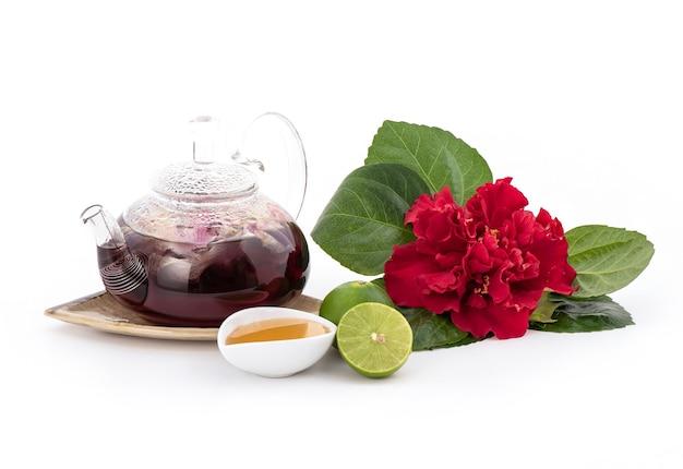 ハイビスカスまたはハイビスカスの花、蜂蜜とレモンが白で分離されました。