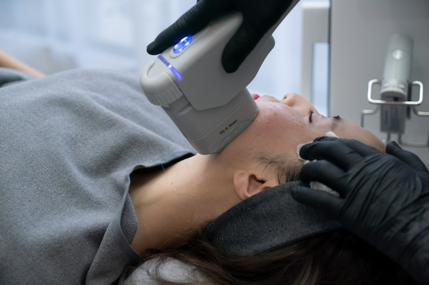 Hifu treatment on female face. high intensity focused ultrasound. anti aging treatment and plastic surgery concept.