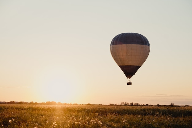 High altitude aerial drone wide view. a collection of hot air balloons are flying through a clear blue sky on a morning in ryazan, russia