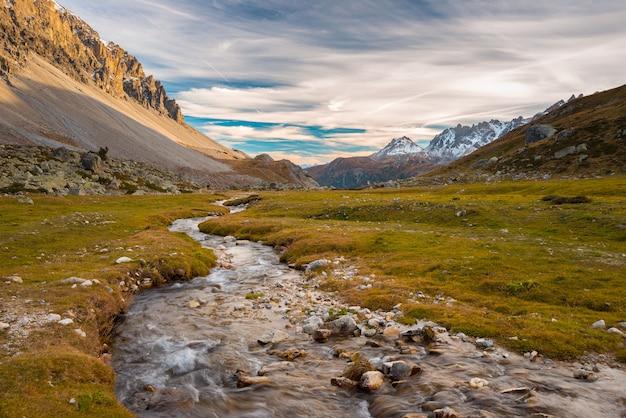High altitude alpine stream in autumn season