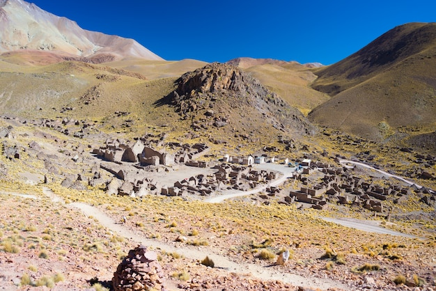High altitude barren mountain range on the highlands of the andes on the way to the famous uyuni salt flat.