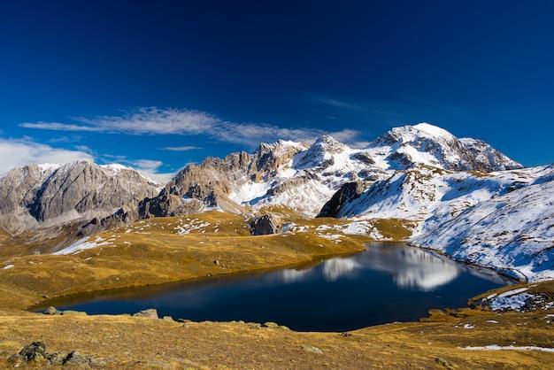 High altitude blue alpine lake in autumn season
