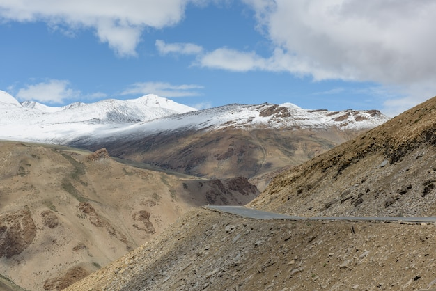 High altitude road on himalayah mountain with snow peak