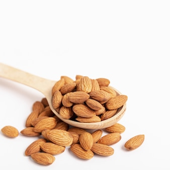 High angle of almonds in spoon with copy space