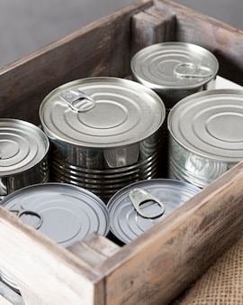 High angle of aluminum cans in wooden crate