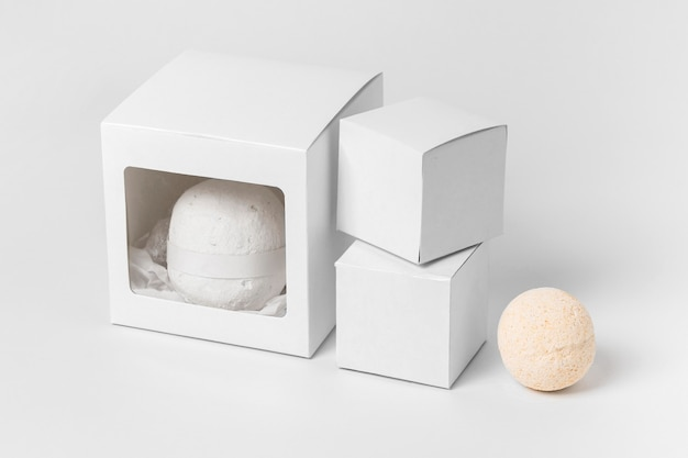 High angle arrangement of bath bombs on white background