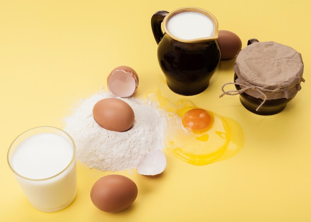 High angle arrangement of different ingredients on yellow background