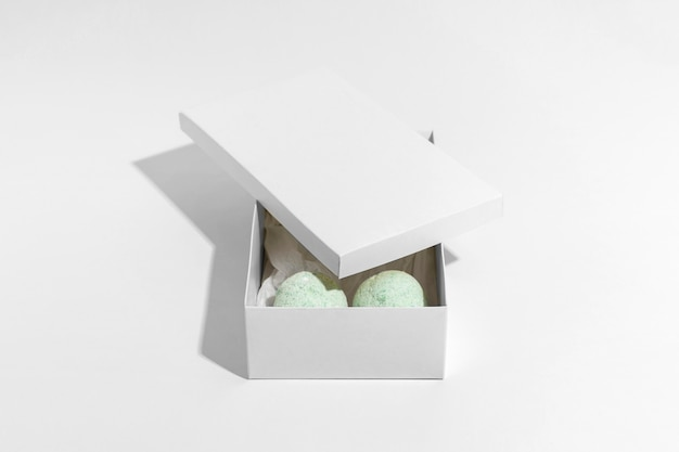 High angle arrangement of green bath bombs in box
