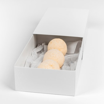 High angle arrangement of orange bath bombs in box