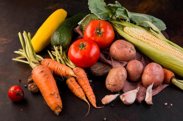 High angle arrangement of vegetables on dark background