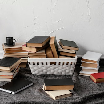 High angle arrangement with books and basket
