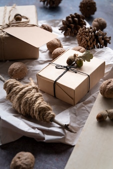 High angle arrangement with boxes and pine cones
