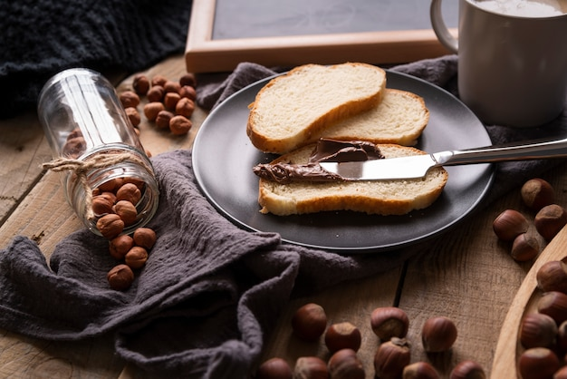 High angle arrangement with bread and hazelnuts
