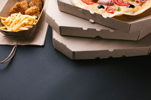 High angle arrangement with pizza and fries