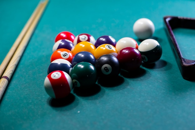 High angle arrangement with pool balls and table