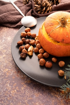 High angle arrangement with pumpkin and hazelnuts