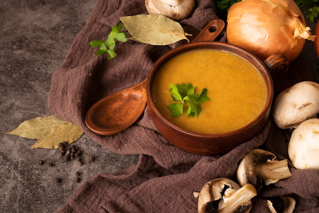 High angle arrangement with pumpkin soup and spoon