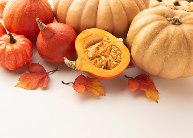 High angle arrangement with pumpkins and white background