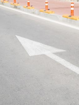 High angle of arrow indicator on asphalt