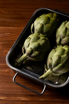 High angle artichokes in tray