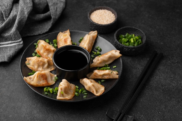 High angle of asian dumplings dish with herbs