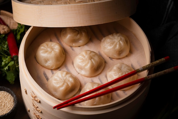 High angle of asian dumplings with chopsticks