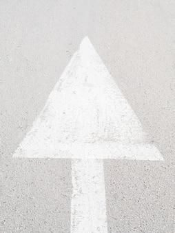 High angle of asphalt with arrow