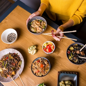 High angle of assortment of asian food on table