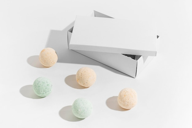 High angle assortment of colored bath bombs on white background