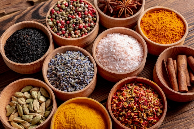 High angle of assortment of spices in bowls