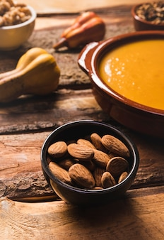 High angle assortment with almonds, soup and pumpkin