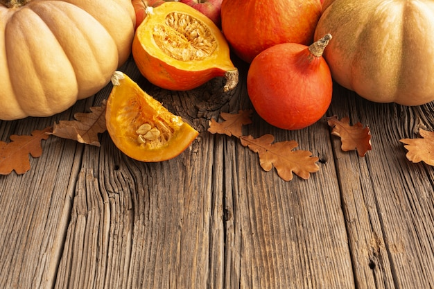 High angle assortment with harvest on wooden background