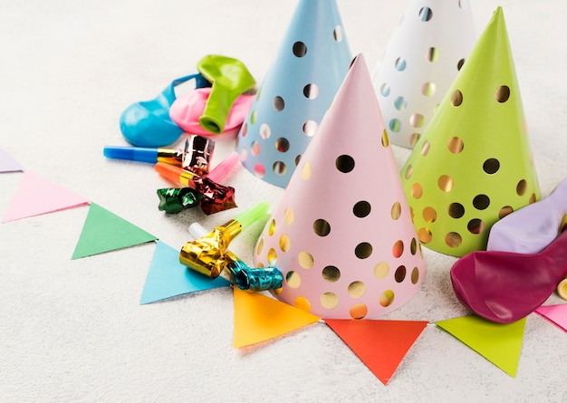 High angle assortment with party hats and whistles