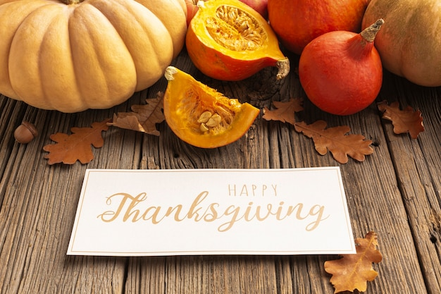 High angle assortment with pumpkins and thanksgiving sign